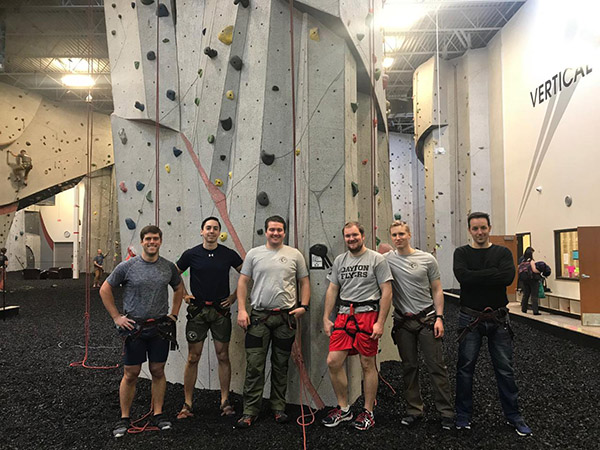 Men taking picture after rock climbing.