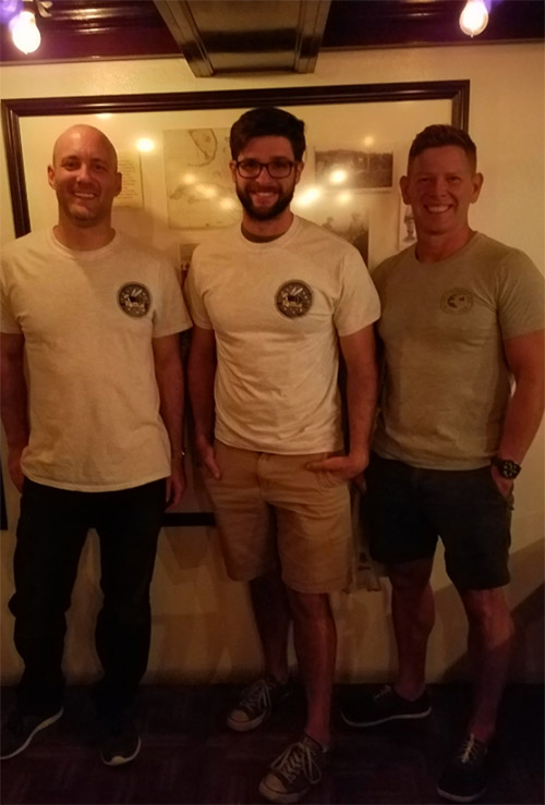 Men wearing TSL shirts.